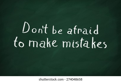 On the blackboard write Don't be afraid to make mistakes