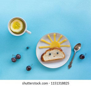 on blue background breakfast morning sun cloud sky rays joy cute sandwich healthy food berries blueberry plum bread cheese plate spoon serving napkin cup tea drink