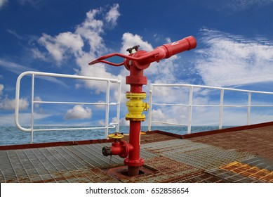 on board fire fighting foam, water gun aboard of tanker ship on blue sky background