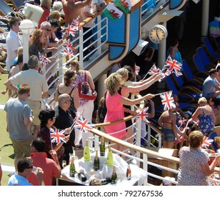 "On board P&O ""Azura"", La Coruna, Spain - June 2014: People with flags and a table with champagne at the party to celebrate leaving port"