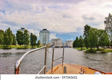 On board of a water bus in Karlstad, on the river Klaralven. Modern skyscrapers and parks on the riverbanks, Sweden, Scandinavia, Europe.