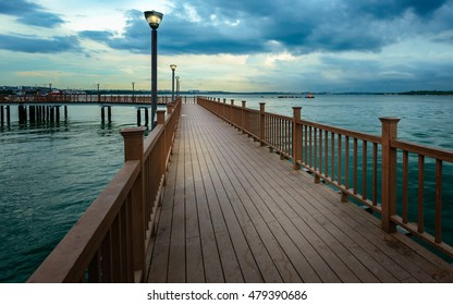 On the Brige, this is an image taken from singapore showing the beauty of the sunset at the sea shore on the bridge.