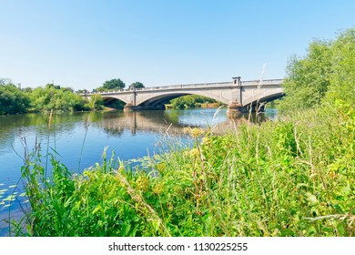 On a bright clear summer day the River Trent flows under Gunthorpe Bridge in Nottinghamshire.