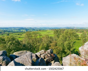 On a bright September morning looking out over the Derbyshire Peak District landscape from the top of Birchen Edge.