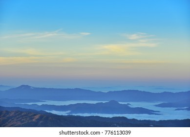 On a brighter day sky without clouds offer to see view of the mountain, Mist in mountain before sunrise in thailand of Doi Luang Chiang Dao chiang mai province.