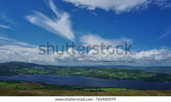 On a clear day, Ireland begins to pop with green fields and inland rivers