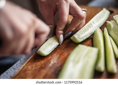 on a cutting board cut fresh cucumbers