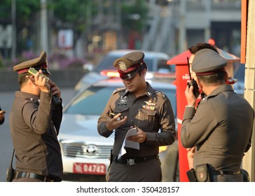 On December 9, 2015. Thai polices was working at the road to protected crime and people's asset. in Bangkok, Thailand.