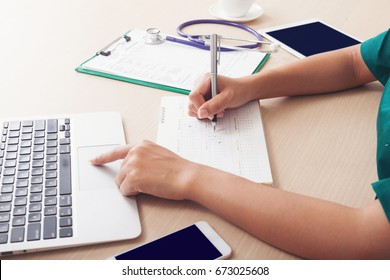 On the desks of busy clinicians. The doctor checks the calendar and schedule appointments with patients to schedule work period. Preparing for vacation after working hard all year.
