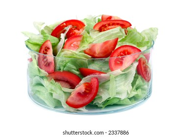 on diet - fresh lettuce and tomatoes in a glass bowl isolated on white background