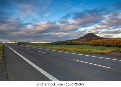 On the empty road in Central Bohemian Highlands, Czech Republic. Central Bohemian Uplands  is a mountain range located in northern Bohemia. The range is about 80 km long