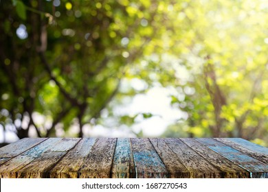 On an empty wooden table on a green abstract blur
