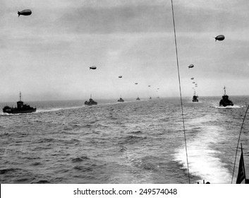 On the English Channel, a convoy in two lines of landing craft head for Utah Beach on D-Day. The craft traveled in paths cleared of mines before the invasion. June 6, 1944.