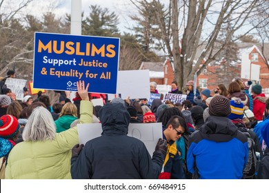 On February 1, 2017, the community of Durham (NH) marched against President Trump's travel ban preventing Muslims to enter the USA. A woman holding a blue sign supporting Muslims