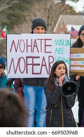 "On February 1, 2017, the community of Durham (NH) marched against President Trump's travel ban preventing Muslims to enter the USA. A protester holds a  sign supporting Muslims: ""No hate No Fear"""