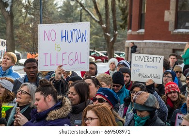 On February 1, 2017, the community of Durham (NH) marched against President Trump's travel ban preventing Muslims to enter the USA. Protesters raise human right sign