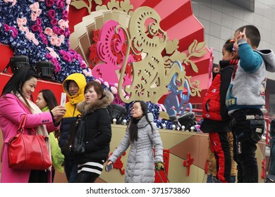 On February 8, 2016 is a traditional Chinese New Year,  of the former in the New Year. Here on January 30, 2016 tourists in xi 'an bell tower square, a monkey in the cartoon.