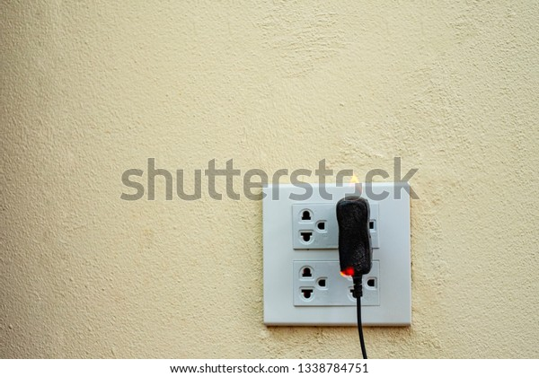 On Fire Electric Wire Plug Receptacle | Technology, Objects ... Wiring A Plug Outlet on