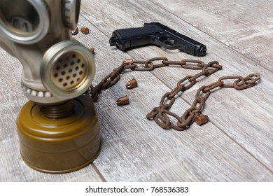 On the floor,are a gas mask is a chain, a pistol and a few raspy cartridges.