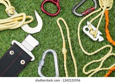 on the grass the concept of things for insurance and rope for the mountains