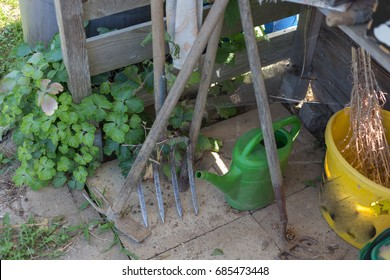 on a hot summer day in a cottage garden various huts and small chests for storage and gardening tools are in an area near stuttgart in south germany