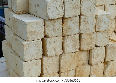On the islands of Malta the typical yellow limestone is the brick for all houses, walls and structures. This limestones and ready for building or wall constructions - seen on island of Gozo