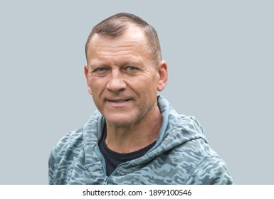 on an isolated background mature man, handsome, sporty, smiling