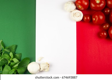 On Italian flag are Italian food ingredients: basil, tomato, garlic, mushroom.
