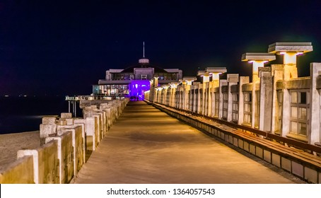 on the jetty of blankenberge beach, belgium, popular city architecture by night