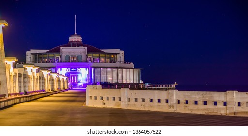 on the jetty platform of blankenberge beach, Belgium, Popular Belgian city architecture lighted by night