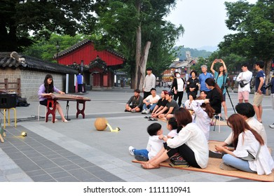 On June 8, 2018, Young korean musicians are doing traditional Korean busking in front of the Gyeonggijeon in Jeonju Hanok Village, South Korea.