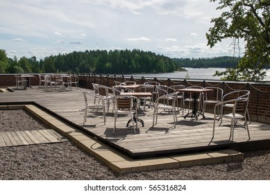 On the lake on a special site area with tables and chairs.
