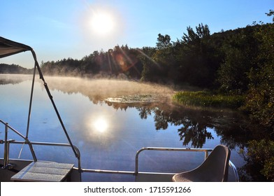 On the lake we see a small mist as we approach autumn. This announces a beautiful day of vacation. Valcourt, Quebec, Canada; September 17, 2012.