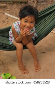 On Lang, Vietnam, Januar 3, 2017: Unidentified little smiling asian girl swinging in hammock on vietnamese village background in Vietnam, Januar 3, 2017.