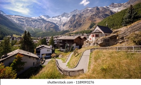 On a late september day the sun is shining on Saas-Fee, the main village in the Saastal, or the Saas Valley, and is a municipality in the district of Visp in the canton of Valais in Switzerland.