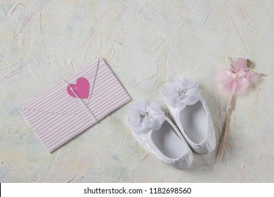 01472130f on a light background a white booties made of lace for a girl