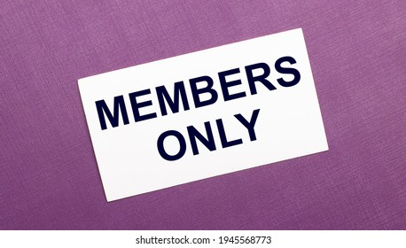 On a lilac background, a white card with the words MEMBERS ONLY