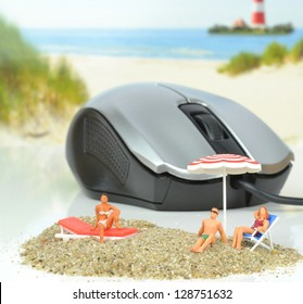 On line holiday concept with mouse and sunbathers on beach