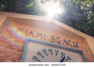 On location in Miami Beach. Landmark Miami Beach sign with thermometer