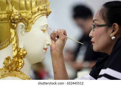 On May 25,2017; worker rest under on a deity painting which will decorate the royal crematorium for the late Thai King Bhumibol Adulyadej's cremation ceremony, at Sanam Luang in Bangkok,