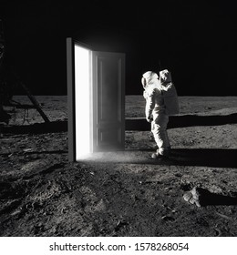On the Moon. Astronaut standing in front of an mysterious open door to another world.   Image with 3d rendering element and vintage film camera effects. Elements of this image furnished by NASA.
