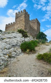 On the mountain stands an ancient castle.It is a historical landmark.
