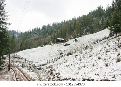 on a mountainside that is covered with snow is located one house which is located in an ecologically clean area