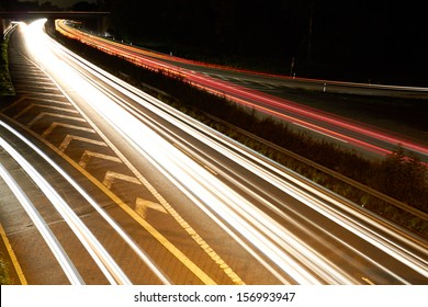 On the night propelled at a long exposure light trails produce cars with their headlights.