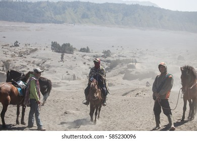 On Oct 24, 2015 : Tourist trekking along Mount Bromo misty ridge during sunrise. Mount Bromo is an active volcano famous for beautiful view. At Mount Bromo, Surabaya, Indonesia.