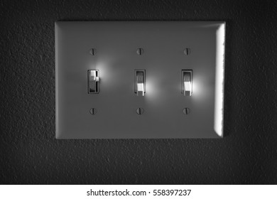 On and off light or power switch on wall with highlights