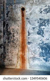 On old pipe has created a rusty water stain on a concrete wall inside Fort Casey on Whidbey Island in Washington State.