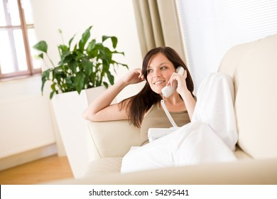 On the phone home: woman calling in living room