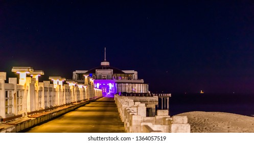 on the pier of Blankenberge beach, Belgium, Popular city architecture lighted by night
