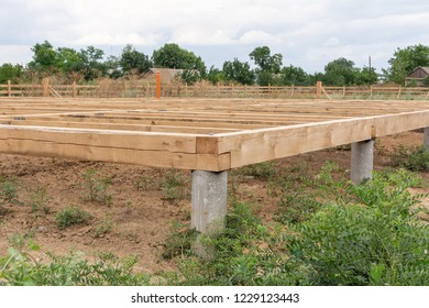 On pile foundations support the floor of a frame house